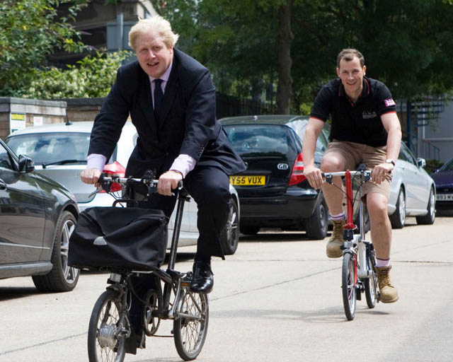 Boris Johnson riding a brompton bike
